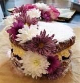 Ultimate sponge upgrade! Top your ultimate sponge with our classic flower addition - £8 extra